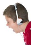 Weinig jongen in oortelefoons stock fotografie