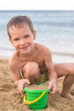 Weinig jongen op de kust Royalty-vrije Stock Afbeelding