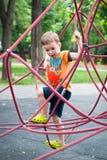 Weinig jongen op de speelplaats Royalty-vrije Stock Foto