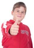 Weinig jongen rekt een vinger uit stock foto