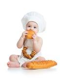 De jongen die van de baby koekje eten royalty-vrije stock foto's
