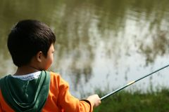 Weinig jongen visserij Royalty-vrije Stock Afbeelding
