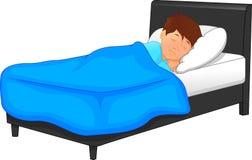 Weinig jongensslaap in bed Stock Afbeeldingen