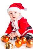 Weinig leuke babygnoom in rood Stock Fotografie