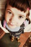 Weinig mooi meisje met bruine haarvlechten royalty-vrije stock afbeeldingen