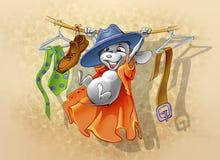 Weinig muis het spelen in de kast met kleren Royalty-vrije Stock Fotografie