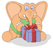 Weinig olifant met een heden in de doos Stock Afbeeldingen