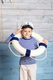 Weinig reddingsboei van de jongensholding Stock Foto's