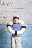 Weinig reddingsboei van de jongensholding Stock Fotografie