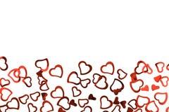 Weinig rode confettiharten op witte achtergrond royalty-vrije stock afbeelding