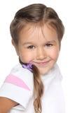 Weinig schoolmeisje. Portret op witte achtergrond Royalty-vrije Stock Fotografie
