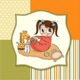 Weinig spel van het babymeisje met haar stuk speelgoed Stock Afbeeldingen