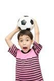 Weinig speler van de de voetbalsport van de jongensholding Royalty-vrije Stock Foto