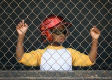 Weinig Speler van het Honkbal van de Liga in Dugout 3 royalty-vrije stock foto