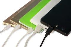 Weinig telefoons die met kabels belasten stock afbeeldingen
