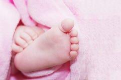 Weinig voet in roze Royalty-vrije Stock Afbeeldingen