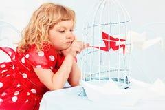 Weinig vogel in een kooi Royalty-vrije Stock Afbeelding