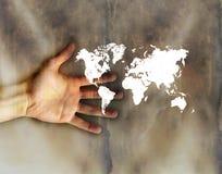 weinig Wereld op hand Stock Afbeeldingen