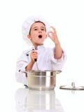 Weinig zingende jongenschef-kok in eenvormig Stock Afbeelding