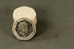 Weinlese, die Münzen des britischen Pfunds schaut; Währung Großbritanniens lizenzfreies stockbild