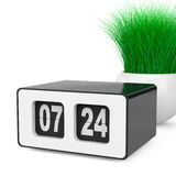 Weinlese Flip Clock mit Gras im weißen Keramik-Pflanzer 3d zerreißen Lizenzfreie Stockfotografie