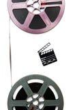 Weinlese 8mm purpurrote und graue Filmspulen und wenig Scharnierventilbrett Stockbild