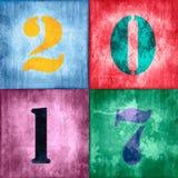 2017, Weinlese nummeriert auf Schmutz buntem Texturhintergrund Lizenzfreie Stockbilder