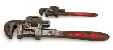 Weinlese-roter Griff-Rohr-Schlüssel stockbild
