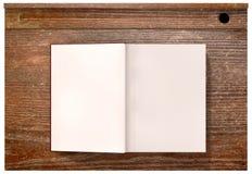 Weinlese-Schuldesktop mit offenem leerem Buch Lizenzfreie Stockbilder