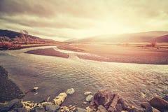 Weinlese tonte Bild eines szenischen Sonnenuntergangs über Yellowstone-Nation Stockbilder