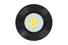 Weinlese-Vinylscheibe mit gelbem Adapter Lizenzfreie Stockfotos