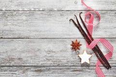 Weinlese-Weihnachtsgewürzhintergrund Stockfotos