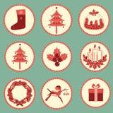 Weinlese-Weihnachtssymbole lokalisiert für Design Stockbild