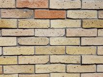 Weinlesebacksteinmauerhintergrund blockiert braune gelb-orangee Farbstruktur Lizenzfreies Stockbild