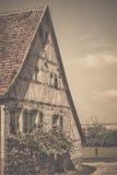 Weinlesebild des mittelalterlichen deutschen Hauses Stockbilder