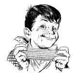 Weinlesefünfziger jahre Junge, der Mais isst Stockbilder