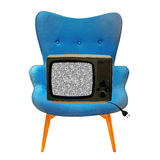 Weinlesefernsehen auf einem blauen Stuhl Stockfoto