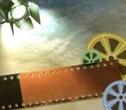 Weinlesefilm-Streifenhintergrund mit Spulen und Reflektor Stockbild