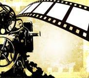 Weinlesefilm-Streifenhintergrund und alter Projektor Lizenzfreies Stockfoto