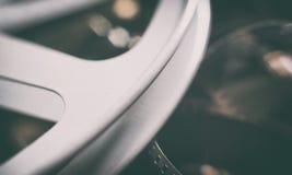 Weinlesefilmgegenstandsymbolspule und -Stehfilm stockbild