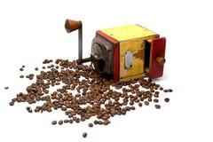 Weinlesekaffeeschleifer mit Kaffeebohnen Stockfoto