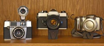 Weinlesekameratrio von drei Jahrzehnten Stockfotografie