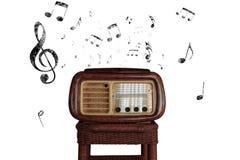 Weinlesemusikanmerkungen mit altem Radio Stockfoto