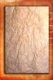 Weinlesepapier auf alter roter Backsteinmauer Stockfoto