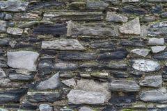 Weinleserustikale Steinwand - Beschaffenheit/Hintergrund der hohen Qualität stockfoto