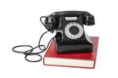 Weinlesetelefon und -buch Stockbild