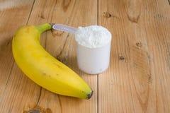 Weiproteïne met en banaan Stock Afbeeldingen