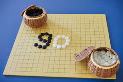 Weiqi: Game of go set (board, stone, and container) Stock Image