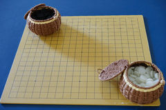 Weiqi: Game of go set (board, stone, and container) Stock Photos