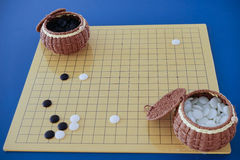 Weiqi: Game of go set (board, stone, and container) Royalty Free Stock Image